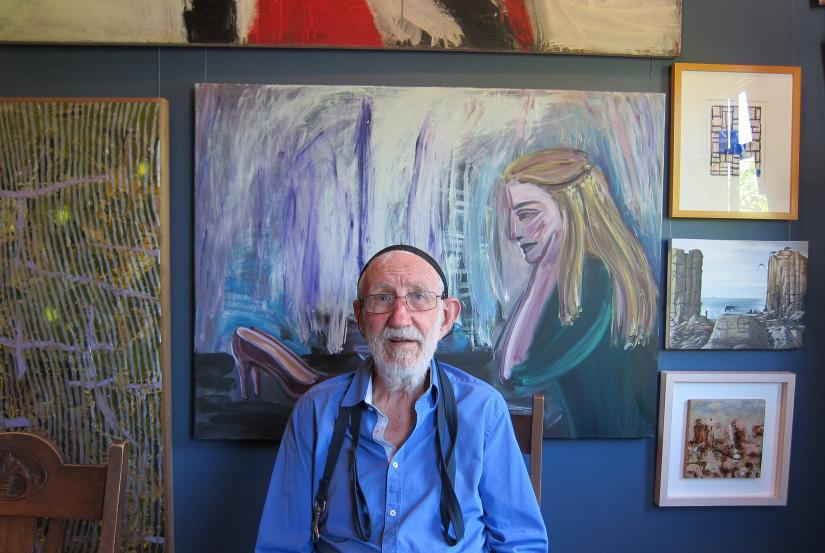 Frank Watters surrounded by his art collection