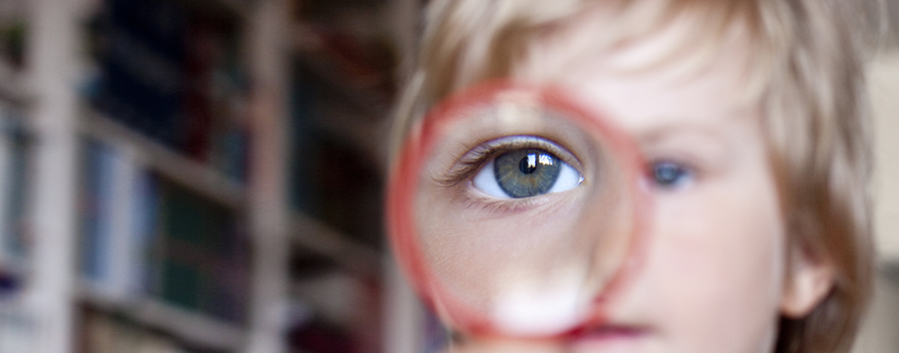 Image of young boy's eye in magnifier