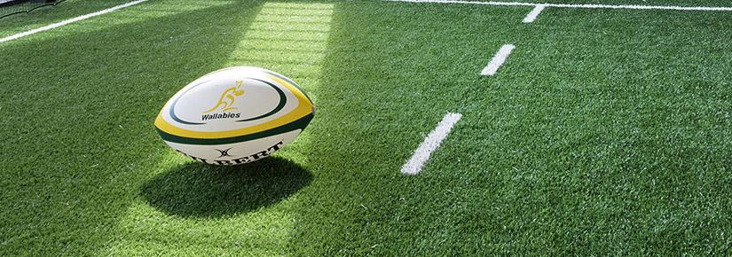 Rugby ball on green astroturf