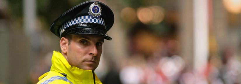 A NSW police officer looks at the camera.