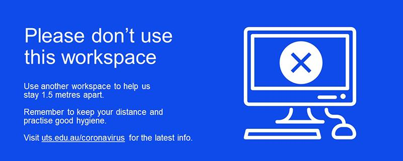 A blue sign says 'Please don't use this workspace'