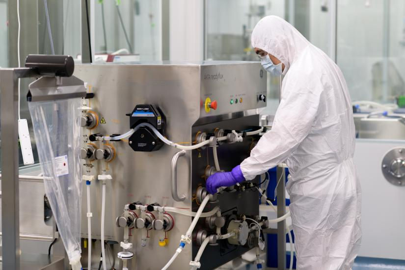 A process engineer operating an ÄKTA ReadyFlux automated single-use tangential flow filtration system.