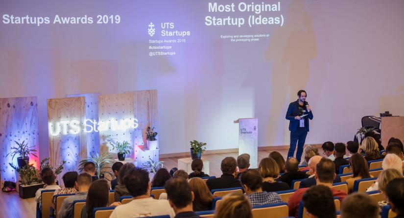 A student pitching their idea at the UTS Startups Awards event in 2019