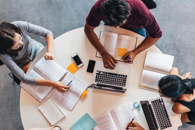 Overhead shot of a group of students around a table