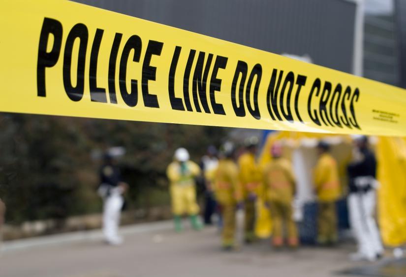 Police tape across a crime scene