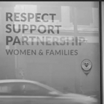 Shot of a window with the words 'respect, support, partnership' in a decal