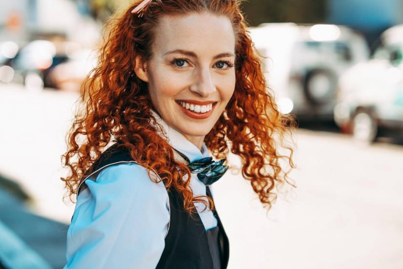 Australia's first female Wiggle Emma Watkins smiling to camera