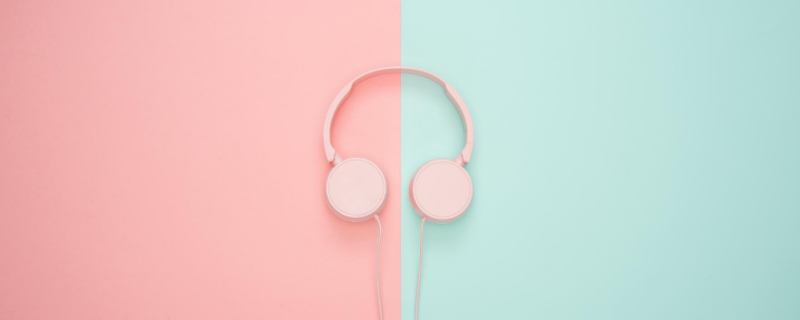 pink and aqua background with pink headphones