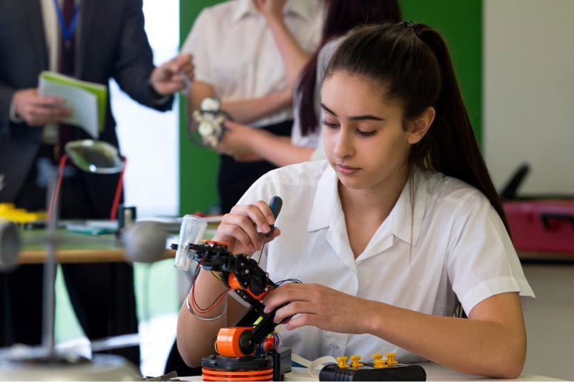 School girl looking at microscope