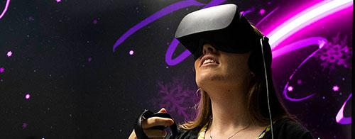 woman uses virtual reality headset