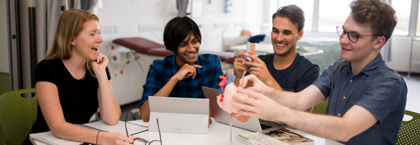 UTS students in a classroom with an anatomical heart model