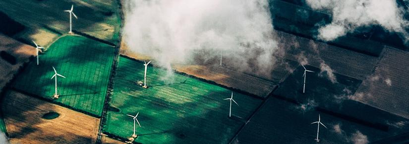 Aerial view of wind turbines in farmland