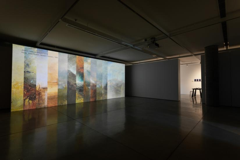 Cloud Studies exhbition in UTS Gallery. Tall video screen with different colourful panels showing.