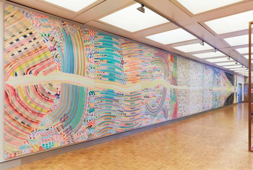 Floor-to-ceiling patterned painting in pastel colours