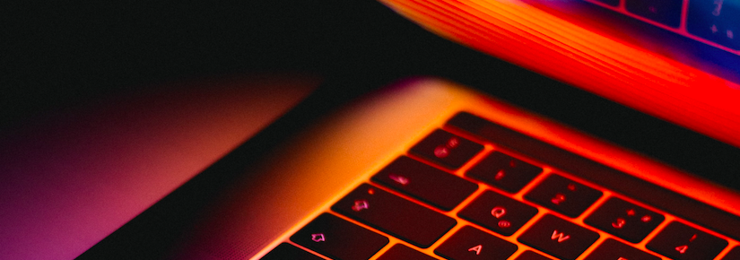 Close up of laptop with bright warm colours on screen
