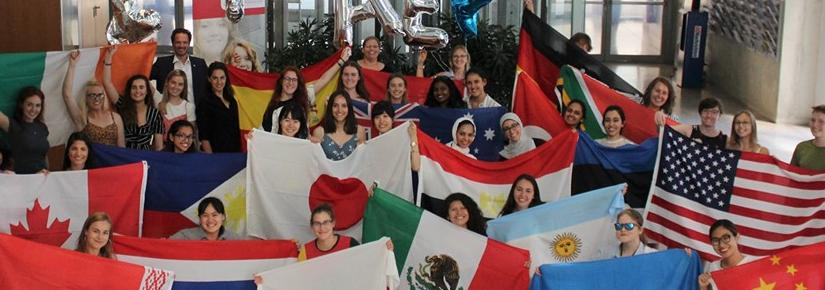 Students proudly hold flags from many different nations