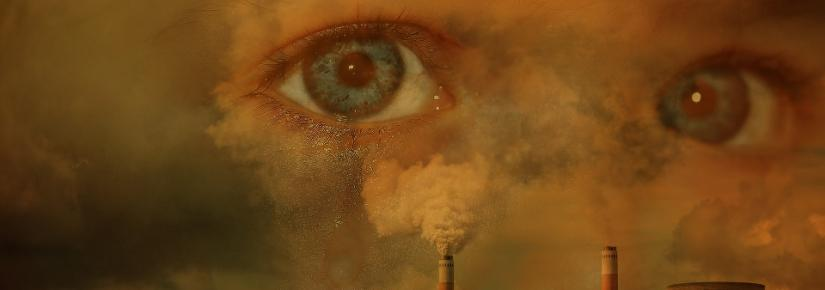 child's eyes superimposed on environmental pollution