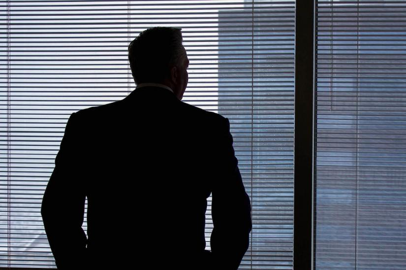 A business person in silhouette