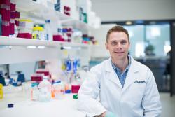 David Suggett sitting in lab