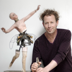 Image of Ken Goldberg with statue