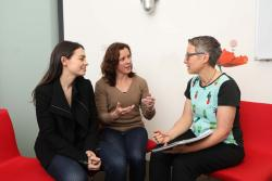 Two female clients sitting and talking with genetic counsellor