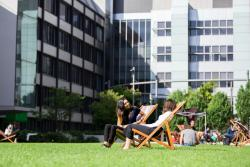 UTS students sitting on the Alumni Green