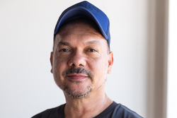 Photo of Stephen Page wearing a cap