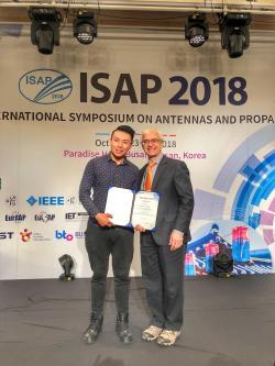 FEIT's Wei Lin receiving an ISAP Award