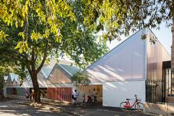 Blackfriars Children's Centre entry with families and a bicycle
