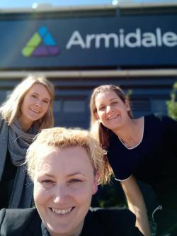 Three women in front of Armidale airport
