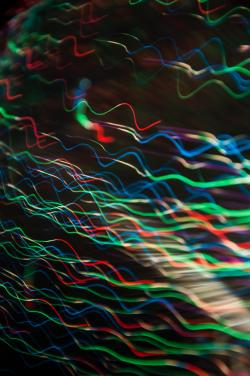 Colourful lines in a disrupted wave pattern