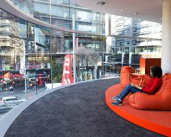 A student relaxes in the red beanbag pod