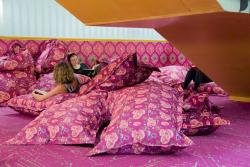Students relax amid the pink cushions of the UTS Library sleep space.