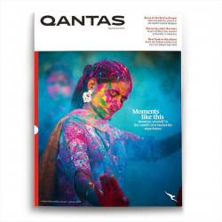 Cover of Qantas magazine depicting a woman dancing during a festival