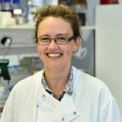 Dr Louise van der Weyden smiling at the camera