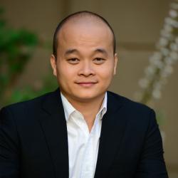 Hoang Dao smiling at the camera