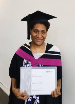 Harriet Rini with her Masters Certificate