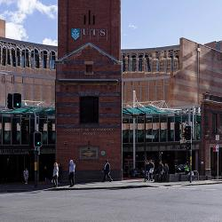 A red-brick heritage facade fronts on to a busy intersection