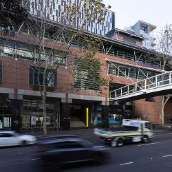The salmon-coloured DAB building stretches along Harris St, connected by a pedestrian foot bridge over the busy road