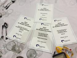 Four certificates laid out on a table