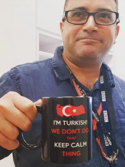 "Seref at the BBC holding a mug that says ""I'm Turkish! We don't do that keep calm thing""."