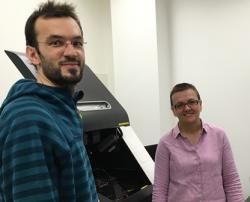 Jean Baptiste raina with UTS i3 Institute's Dr Cynthia Whitchurch with new OMX live imaging microscope