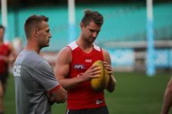 Student Mike Rennie with Sydney Swans player