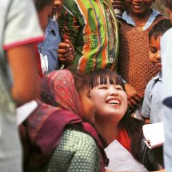 Photo of happy young girl in a crowd of people