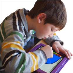 Photo of a child using a tablet device; image by Lexie Flickinger via Flickr