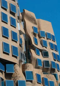 Facade of bricks & protruding, relective windows - Dr Chau Chak Wing building
