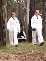 Forensic scientists in field