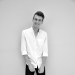 A black and white photo of Lachlan smiling