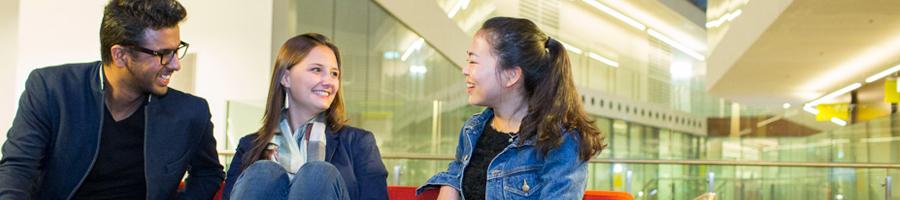 Three international students talking